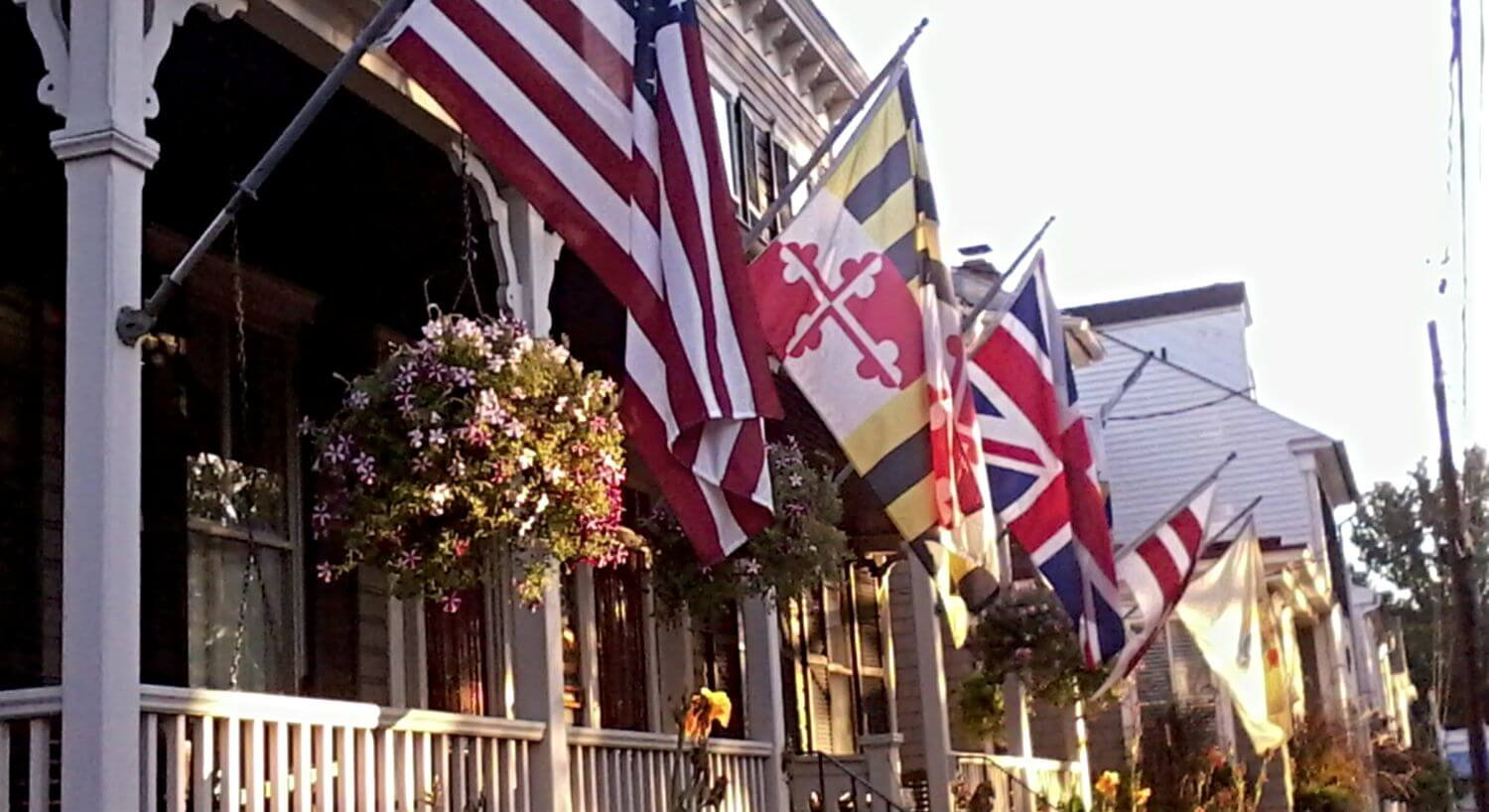 Flags flying from porch of large house in historic area