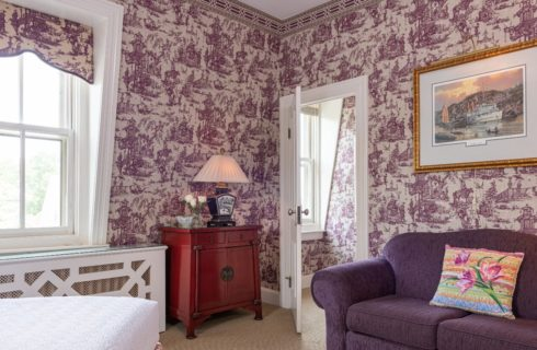 sofa, bed, wall papered room