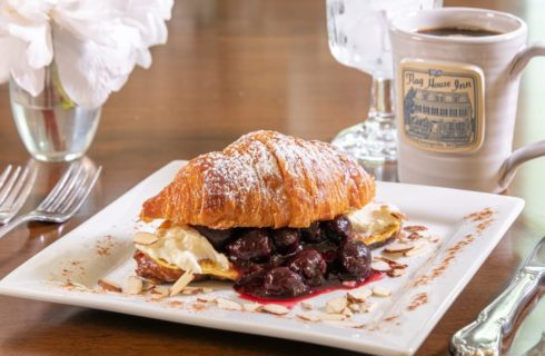 croissant slice with cherry and cheese filling
