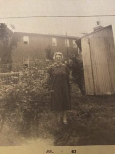 Lady in front of garden