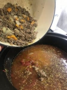 pouring in meat/veggie mixture