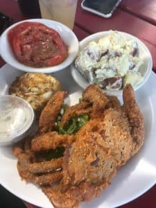 crab cake, softshell crab, potato salad, tomato slice