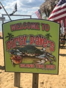 "sign that says ""Dirty Dave's Tiki Bar"""