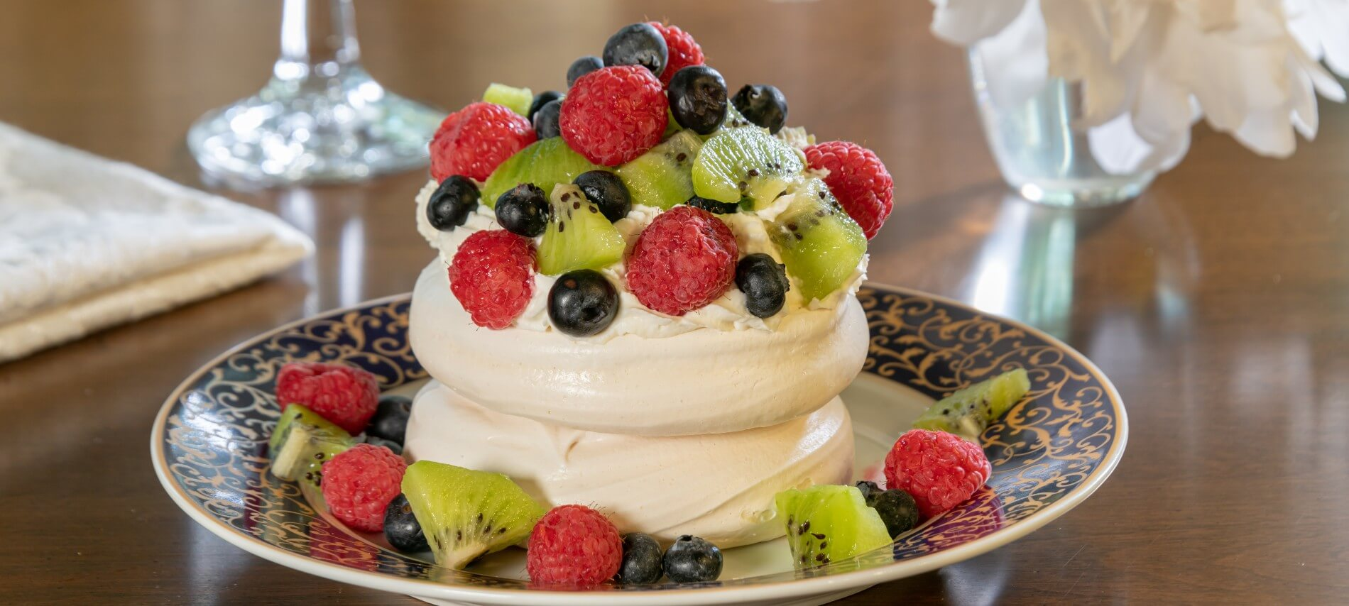 fruit, whipped cream and meringue on a plate