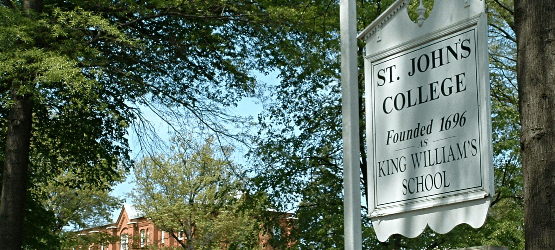 White colonial style sign for St Johns College