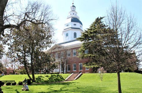 Maryland State House - large brick colonial-style building surrounded by trees