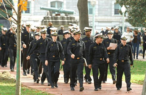 Cadets from the Naval Acdemy walking down a path