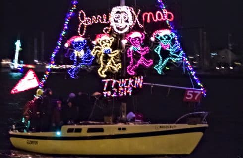 Boat decorated with lights for parade in harbor